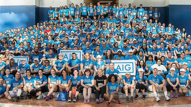 A large group of AIG volunteers pose prior to the American Heart Association's Heart Walk in New York City
